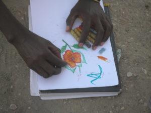 אחד הפליטים מצייר